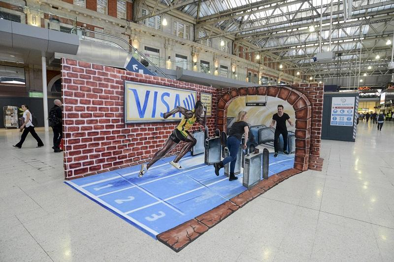 usain-bolt-sprints-to-the-tube-with-contactless-visa-europe-waterloo-station__large